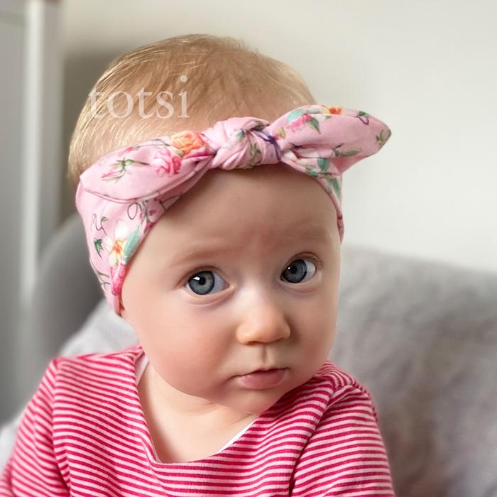 Girl wearing a totsi baby headband